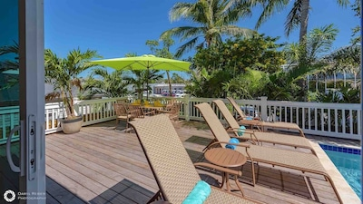 The pool deck has chaise lounges for laying out...