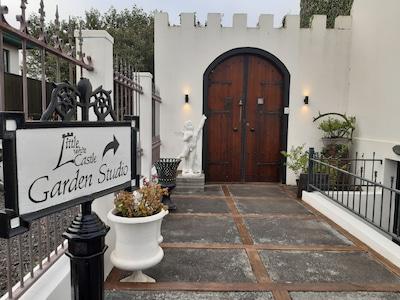 Main entrance to the Garden Studio & the Secret Garden is through the arch door.