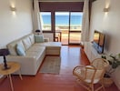 living room and dining area with sea view