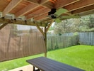 Covered patio with grill, fan and party lights makes for fun outdoor dining.