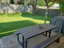 Spacious, fenced back yard with covered patio for family dining