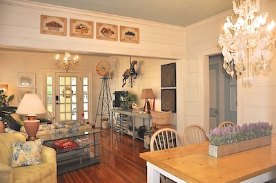 Antiques give living room a warm feel. Carousel horse hangs from the ceiling.