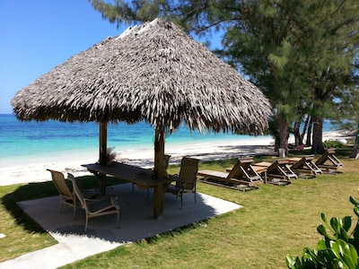 Breathtaking views from your private tikki dining area, right on the beach
