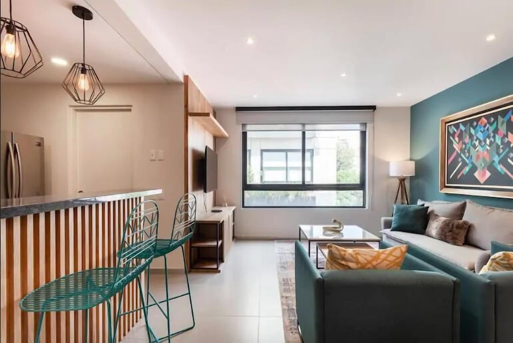 VRBO Mexico City: Living room with large window & modern decor