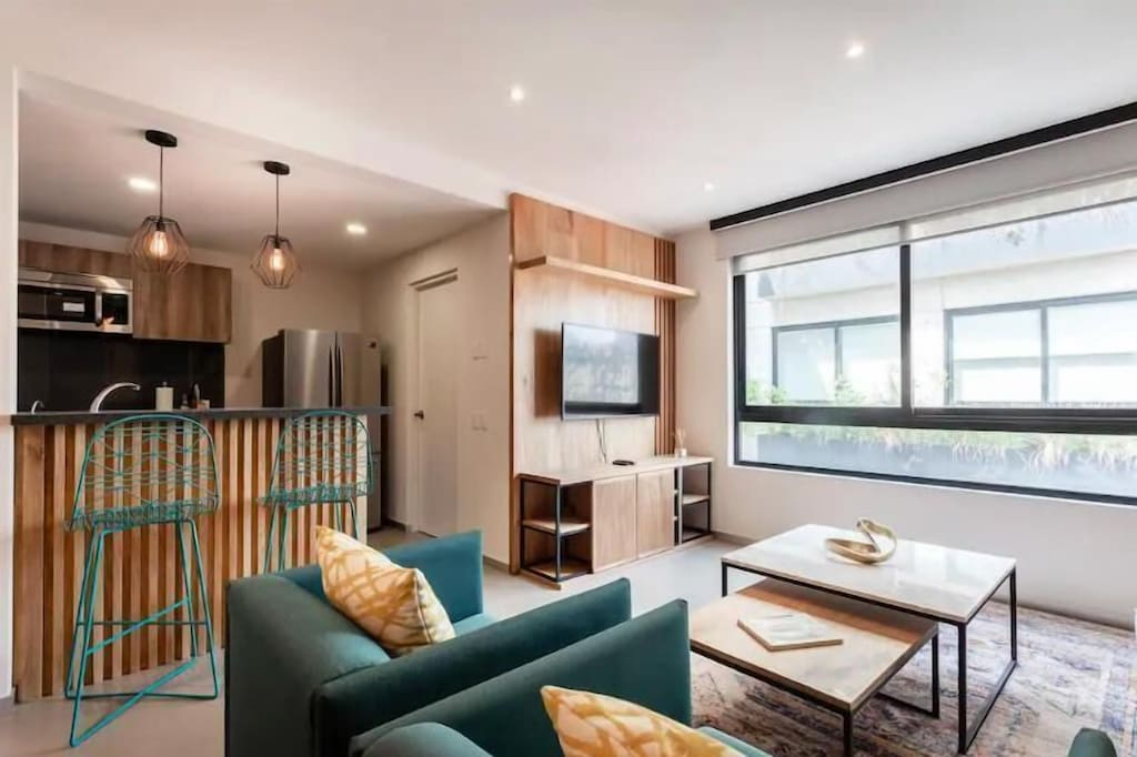 VRBO Mexico City: Living room with large window, large TV and modern decor