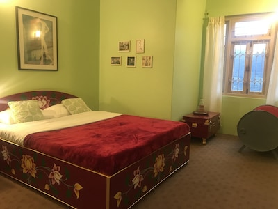 The bedroom.  All the beds are hand painted.