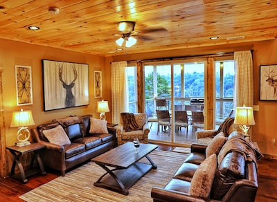 Comfortable furnishings positioned  to enjoy a cozy fire or the view!