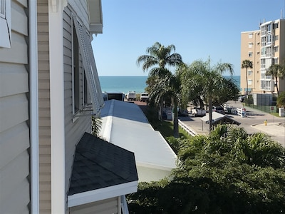 Gulf view from 3rd floor, trolley stop, and beach access with parking area.