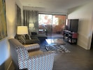 """Inviting, stylish Living Room with lots of seating to watch 60"""" HDTV with DVR"""