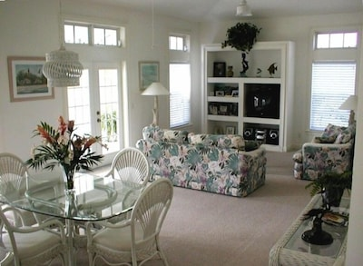 living room with vaulted ceiling and fans