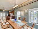 Dining Area - Gather for home-cooked meals at the dining table for 8.