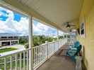 Front Balcony - The front balcony includes plenty of comfortable seating and sweeping neighborhood views.