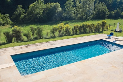 Stunning pool for your private use overlooks forest and riverside.