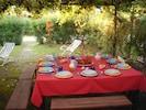 La Bruca-Condominio Mercure, back garden with dining table