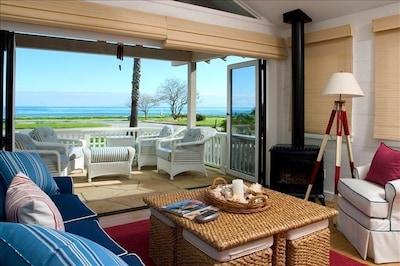 Ocean view from the living room with patio doors open.
