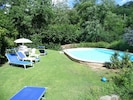 Just relax at the pool within the well kept mature gardens, and bordering stream