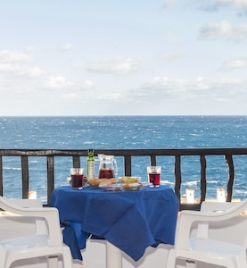 Relax on the balcony with a glass of sangria