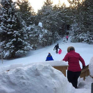 Some of our guests heading out to the toboggan run in our yard
