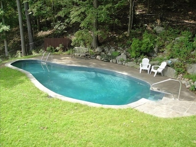 Pool in summer, as seen from deck.