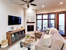 """Living Room - The inviting living room is detailed with a 55"""" TV and gas fireplace."""