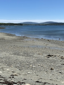 The mountains are larger in reality.  The one on the left is Cadillac Mountain.