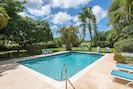 Large pool set in an acre of tranquil gardens with monkeys visiting most days