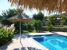 Liakoto Villa pool, garden and barbecue area