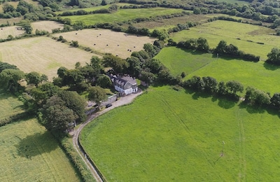 Total privacy with farm land in every direction and the sea views