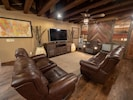 Relax in the main living room on the leather couch or one of the cozy recliners!