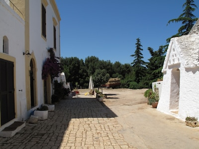 on the right  the Property TRULLI; on the left Property  CASINA