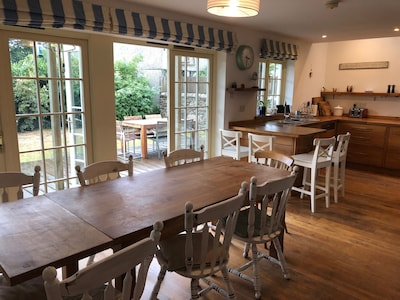 Spacious kitchen-diner opening on to pretty garden