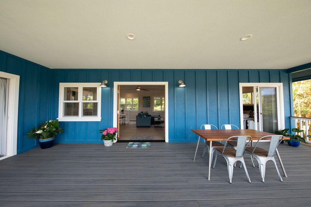 Wooden deck of a petrol-colored house