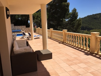 Terrace area with comfortable seating and sun beds