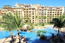 Another balcony view - huge two-level pool & swim-up bar, plus poolside dining