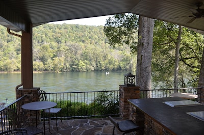 Outdoor kitchen and patio overlooking the river
