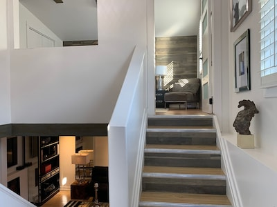 Welcome to The Coach House Loft....two level, open concept, comfort and privacy