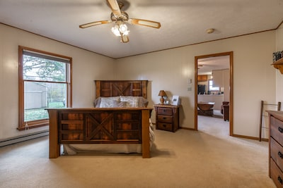 Bedroom features reclaimed wood furniture, from the Youngstown Sheet and Tube.