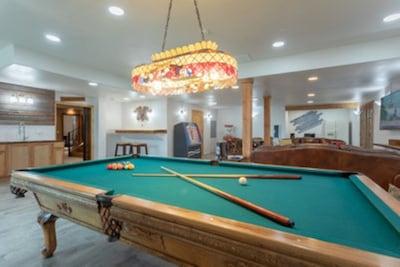 2400 total sq. ft / 1200 sq ft rec. room, three bedrooms, regulation pool table.