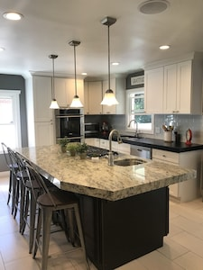 Large updated kitchen.  Fully stocked with dishes and cookware.
