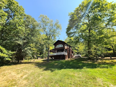 Charming cabin nestled deep in the woods, great for a getaway or event!