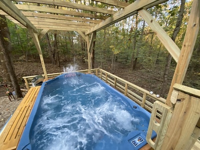 """14 foot """"Swim Spa"""" with waterfall in the woods! Hot shower next to the Swim Spa"""