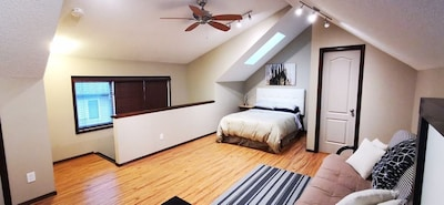 Large beautiful loft on upper level for more bed, washroom, living/working space
