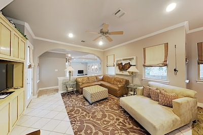 Living Area - This beautiful home features abundant entertaining space.
