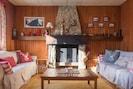 Salon avec vu sur les montagnes, 2 canapés, 3 fauteuils, écran plat