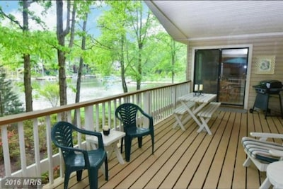Large shady enclosed deck (latching gate at top of outdoor stairs)