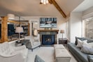 Living Room with Smart TV, Gas Fireplace, and Adjacent Sitting Room