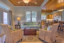 Relax in the living area, which features modern touches and wood ceilings.