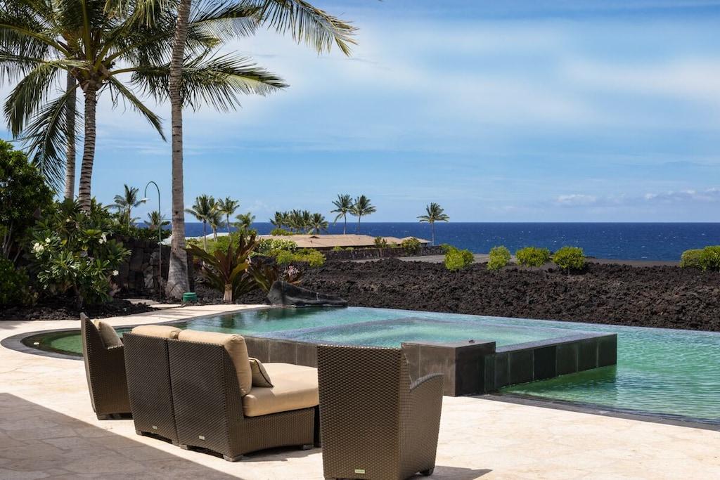 Terrace overlooking a pool and black sand beach on Hawaii Big Island