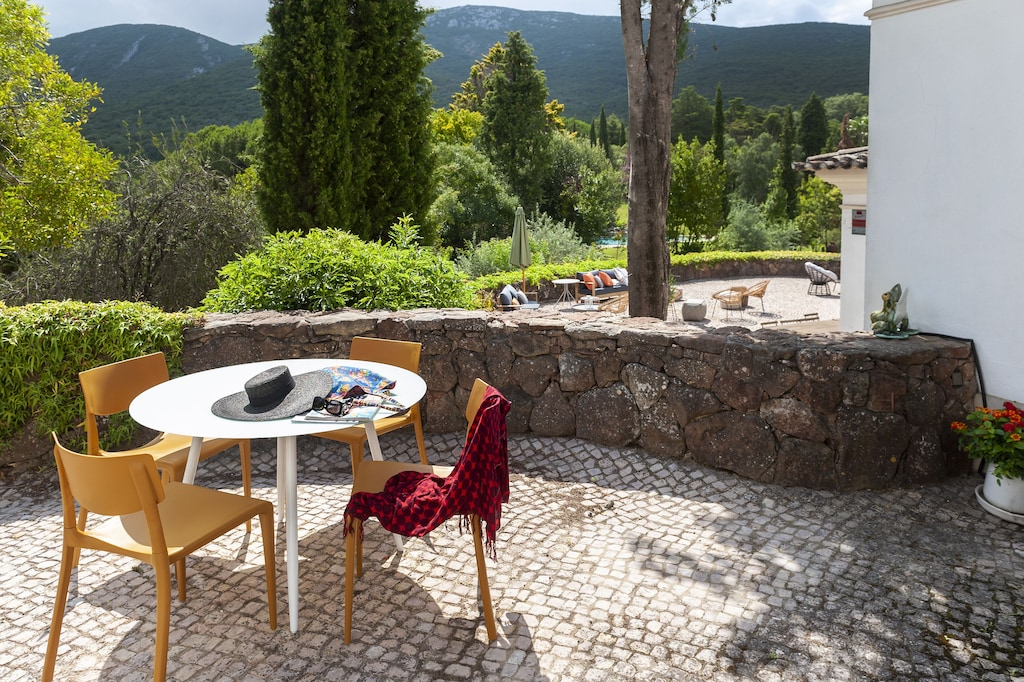 Table on a stone terrace in a mountain setting