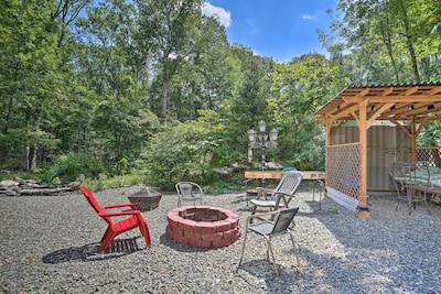 Property Exterior | Charcoal Grill | Koi Pond | Fire Pit